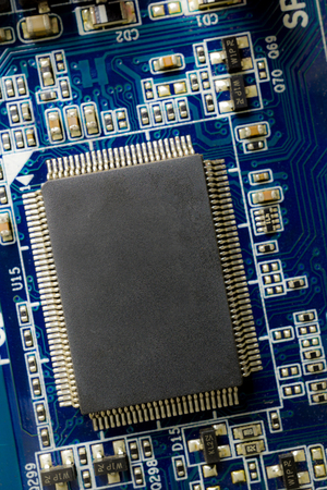 close up background of microchip on blue pcb