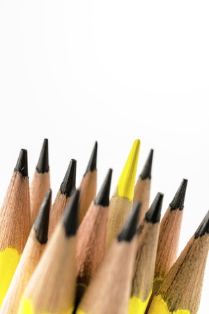 Macro group of pencils and yellow color pencil out of the other meaning to ceartive business , smart idea, success plan, leader thinking on white background
