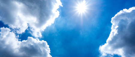 Background of The sun is shinning in the blue sky and cumulus cloud