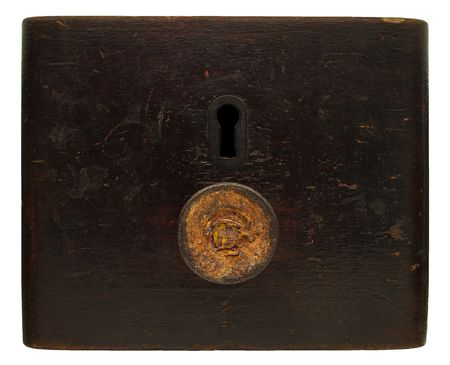 Isolated picture of front old wooden drawer, rusty matel handle and keyhole, close up Stock Photo