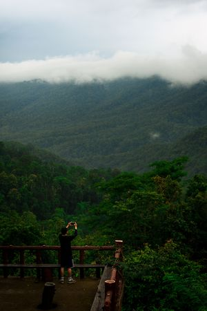 The man taking a picture at view point of Doi Khun Tan National Park