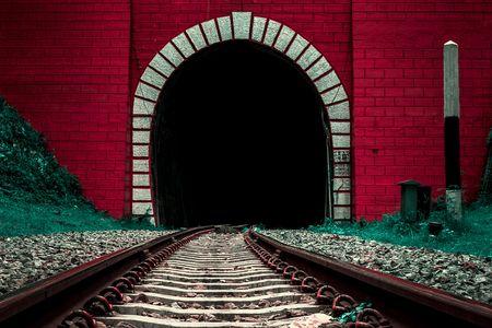 Front of old railway tunnel entrance, surreal color Banco de Imagens