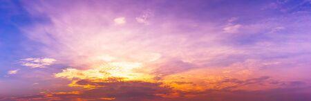 Exotic purple twilight sky and clouds, panorama background, sunrise or sunset scene Banco de Imagens