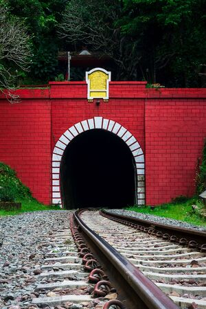 Front of entrance old railway tunnel in mountain