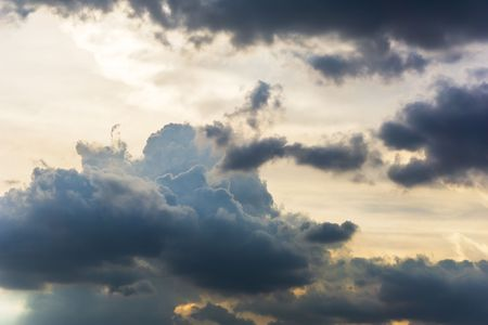 Fluffy cumulus clouds on the sky background