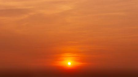 The sun rise on the orange sky and cloud nature backgournd dawn or dusk scene