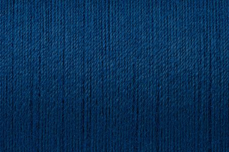 Macro picture of dark blue thread roungh texture surface background