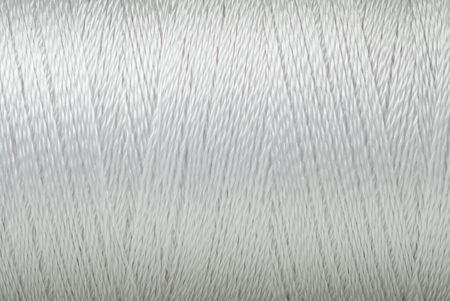 Makrobild des weißen Oberflächenhintergrundes der Fadenbeschaffenheit