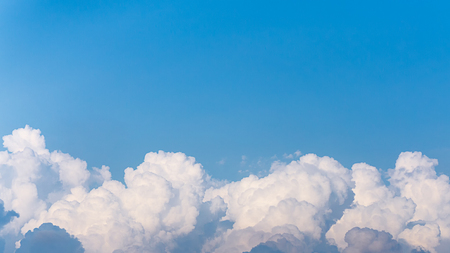 Panorama picture of white fluffy clouds and clear blue sky nature background copysapce