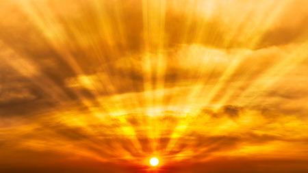 Panorama orage cloudy sky and sun shining beautiful sunrise or sunset scene nature background Фото со стока