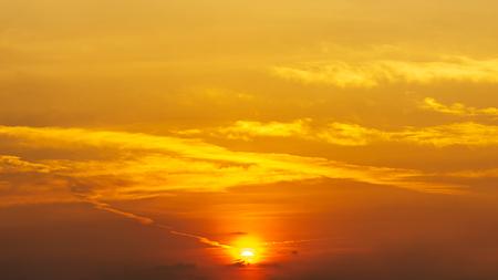 Panorama orange golden hour sky with cloud and sun look like meteor, beautiful sunrise or sunset scene background