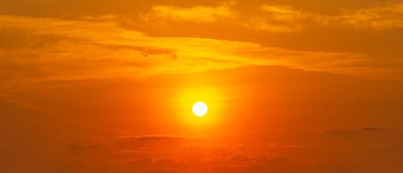 Panorama orange sky and cloud with brightness sun, beautiful nature background