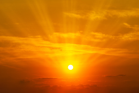 The sun shining on the orange sky and clouds at golden hour time nature background Banco de Imagens