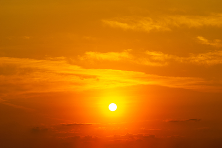 The bright sun on the orange sky and clouds panorama nature background