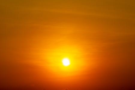 The yellow sun shining on orange sky nature sunrise or sunset scene background Фото со стока