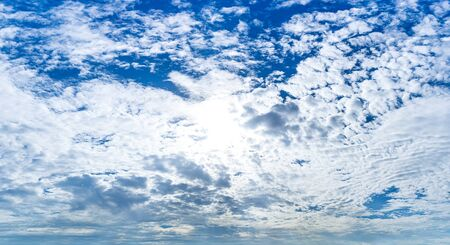 White Fluffy Cloud on blue sky in day time panoramic cloudy background