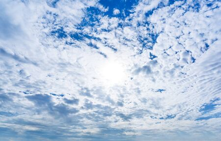 White fluffy cloud on blue messy sky at day time nature background Banco de Imagens