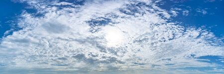 Panorama picture of blue sky full with fluffy whaite clouds and sun at day time nature cloudy background