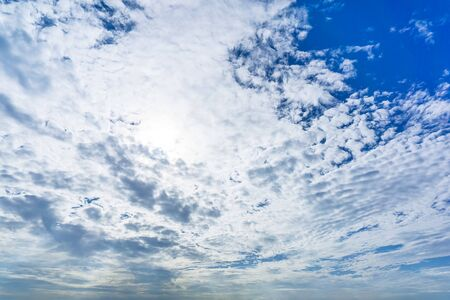 White fluffy messy cloud on blue sky at day time nature background