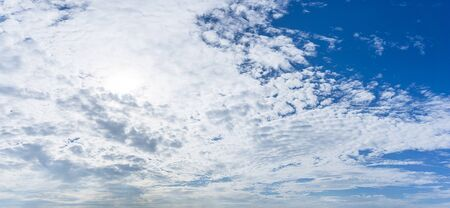 White fluffy cloudy day and blue sky panorama nature background Banco de Imagens