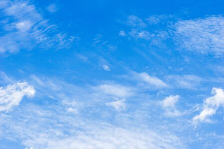 Blue sky and white soft fluffy clouds nature background