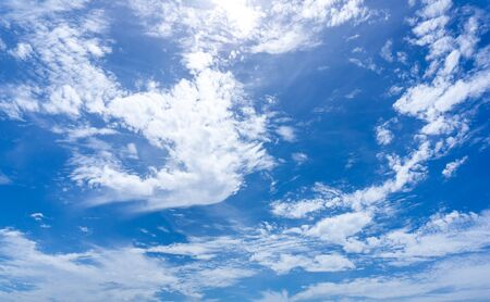White fluffy clouds on blue sky at day time cloudy nature background