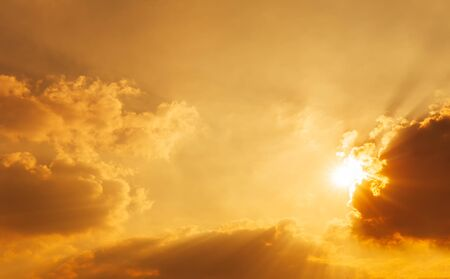 The shining sun on sky and clouds nature orange sky background golden hour time