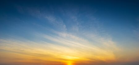 Golden hour sky and clouds with sun light nature panorama background