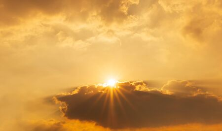 Orange sky and brightness sun behide the cloud nature background sunrise or sunset scene