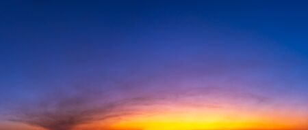 Panorama twilight sky and soft clouds with sun light before sunrise or after sunset nature background