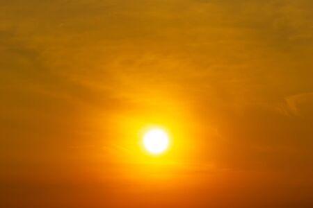 Brightness sun and cloud on orange sky nature background, sunrise or sunset scenic Foto de archivo