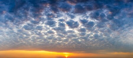 Panorama messy sky with altocumulus cloud and sun, nature sunrise or sunset scenic background Reklamní fotografie