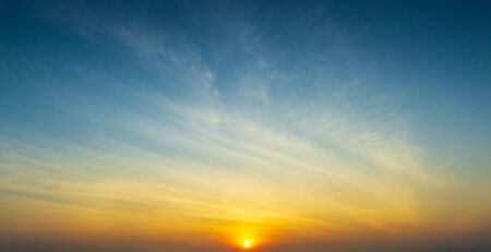 The sun and sky with clouds golden hour time nature sunrise or sunset scene panorama background