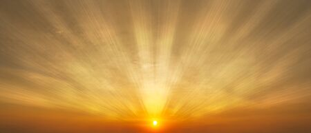 Gorgeous panorama scenic of the sunrise or sunset with sunlight and cloud on the orange sky Фото со стока