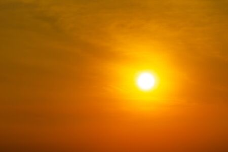 The brightness yellow sun on orange sky and clouds nature background