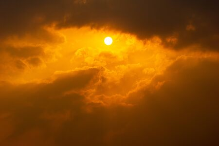 The sun bright on dramatic cloudy orange sky nature background
