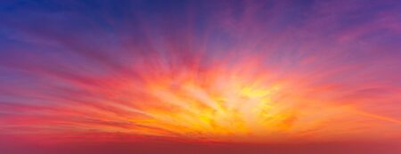 Panoramic picture of twilight sky blast and golden clouds nature background Фото со стока