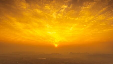 the sun on golden hour sky and clouds view from top mountain landscape nature background