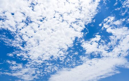 Blue sky full of White fluffy clouds in daytime nature background