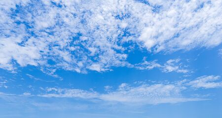 Blue sky and White fluffy clouds in daytime nature background
