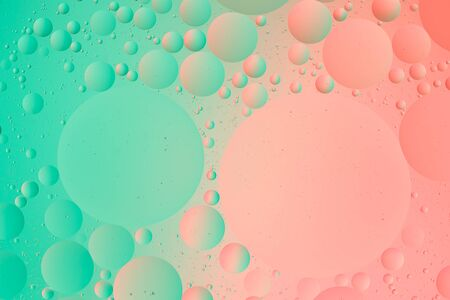abstract macro background of water and oil image green and pink color gradient wallpaper Фото со стока