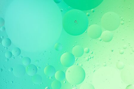 Abstract pastel green color macro background of oil bubbles on water Фото со стока - 148595303