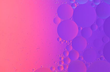 Abstract colorful macro background of oil on water purple color with copy space