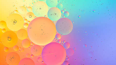 Abstract colorful macro background of oil droplets on water