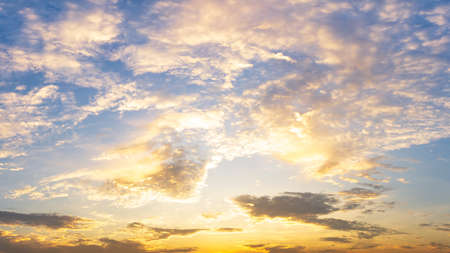 Cloudy golden sky nature background sunrise or sunset time