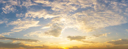 Cloudy golden sky nature panorama background sunrise or sunset time
