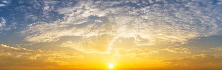 Golden sunrise with cloudy sky nature panorama background 版權商用圖片