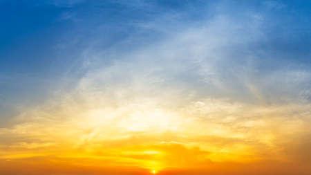 Orange sunrise and fluffy cloud blue sky nature background 版權商用圖片