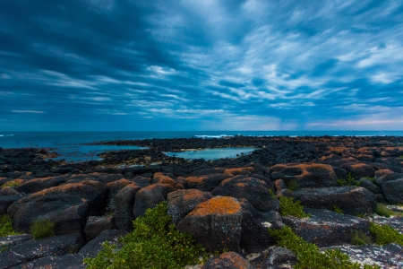 Dusk  Sunset  over black volcanic rocky tidal pool and sky full of rolling cloud in Port Fairy, Victoria, Australia  photo