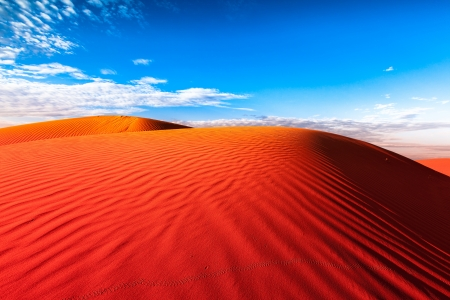 sandhills: Red outback ripple sand dune desert with blue sky.